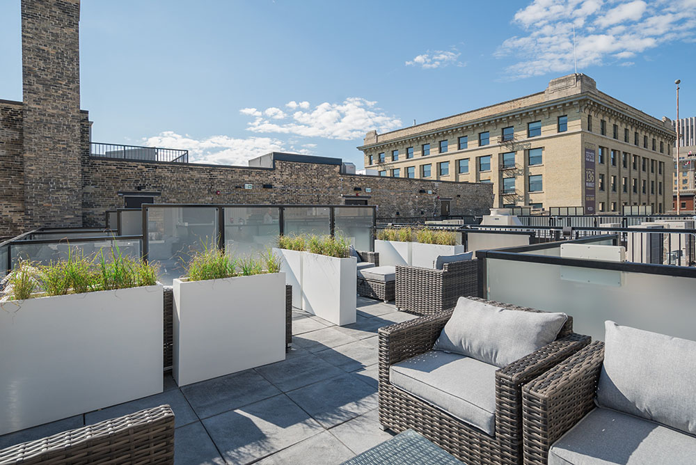 Relax on the rooftop terrace of the District a multi-family development built by Streetside Developments in Winnipeg.
