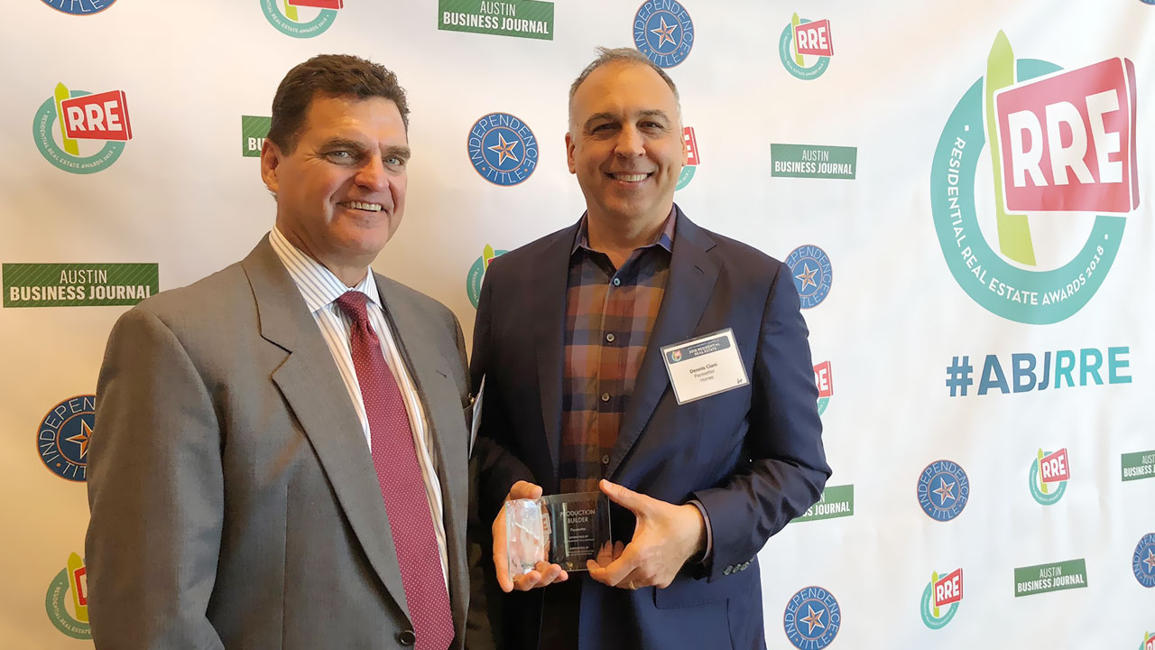 Tom Lynch, VP of Pacesetter Homes Texas, and Dennis Ciani, Marketing Manager, accept an award from the Austin Business Journal.