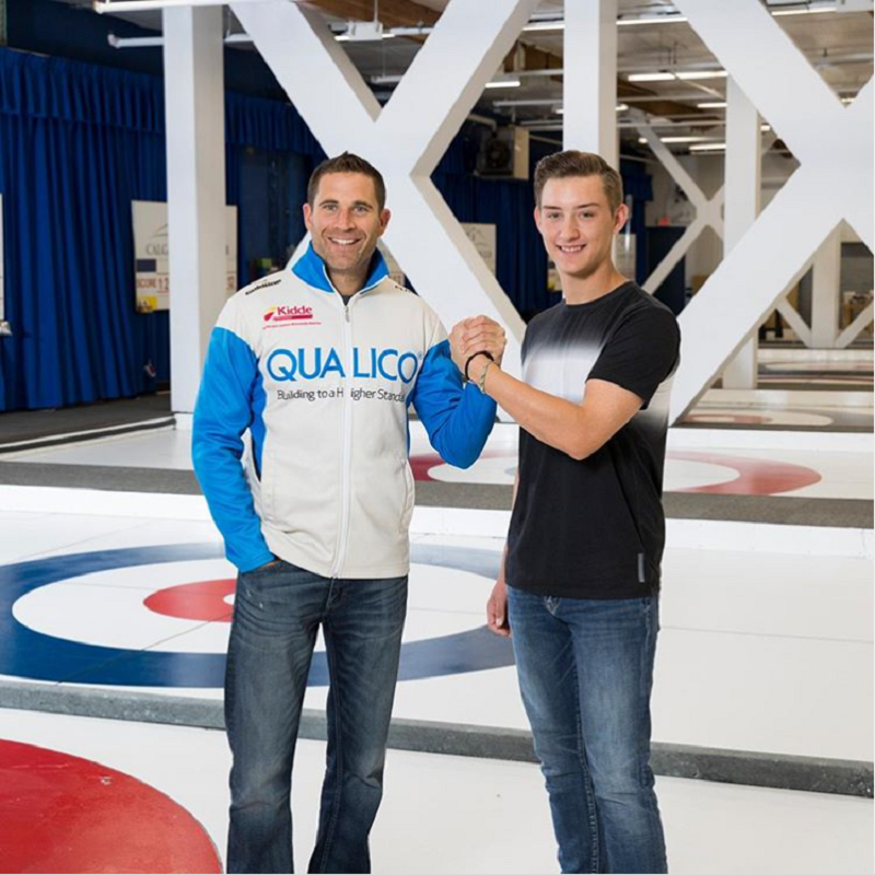 Big Brother John Morris on the curling rink with mentee