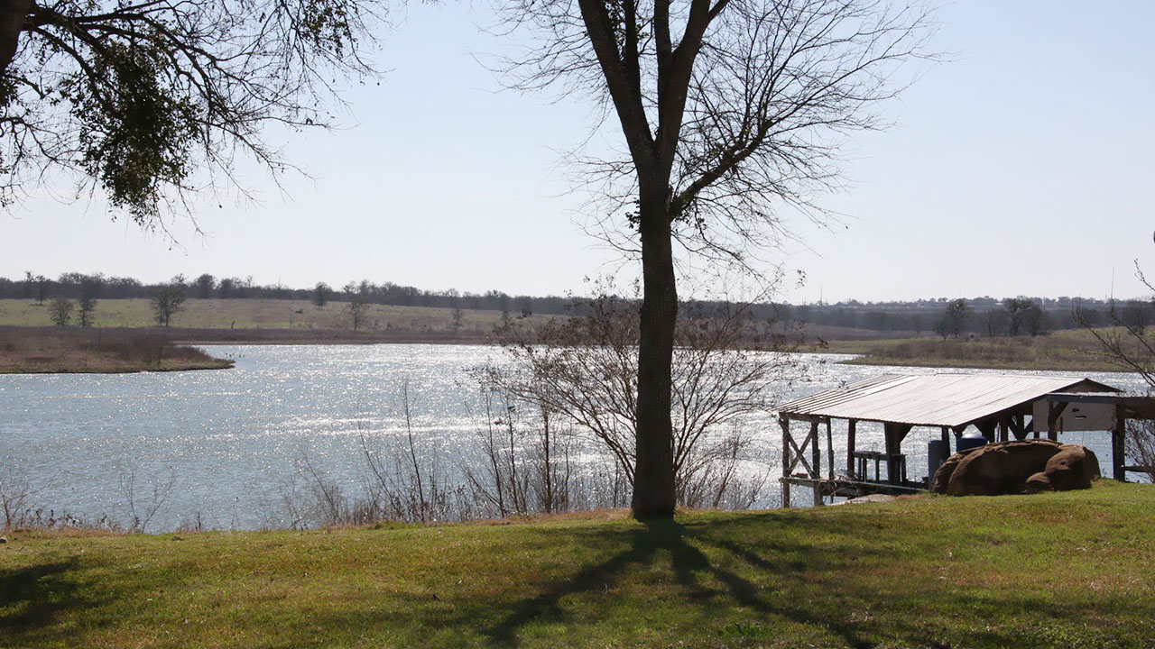 Enjoy a walk around the lake in the community of Sun Chase.