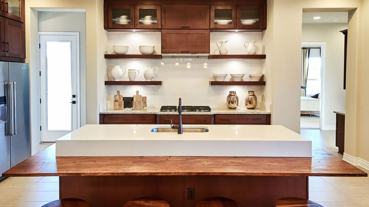 Cooking will never feel like a choir in the kitchen of the La Ventana by Hill Country Artisan Homes.