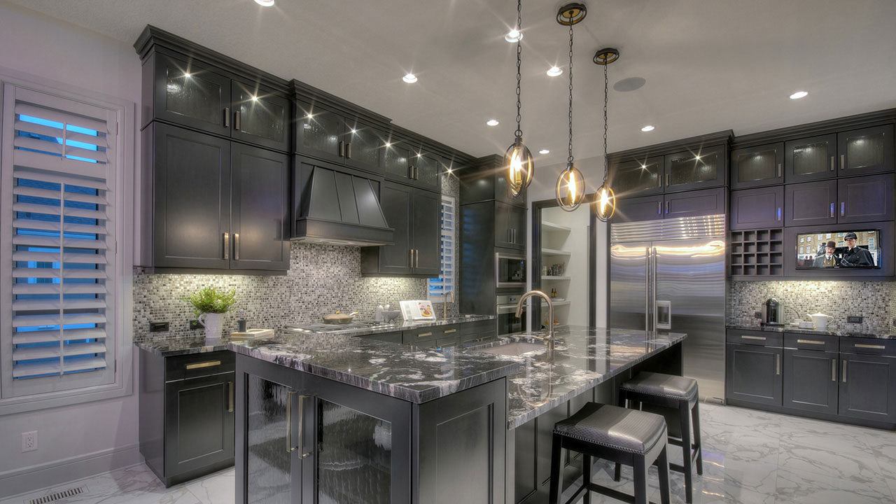 The elegant kitchen in the Westwood by Augusta Fine Homes in Calgary.