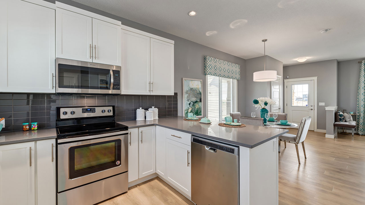 The kitchen in the Greystone, built by Pacesetter Homes Calgary.