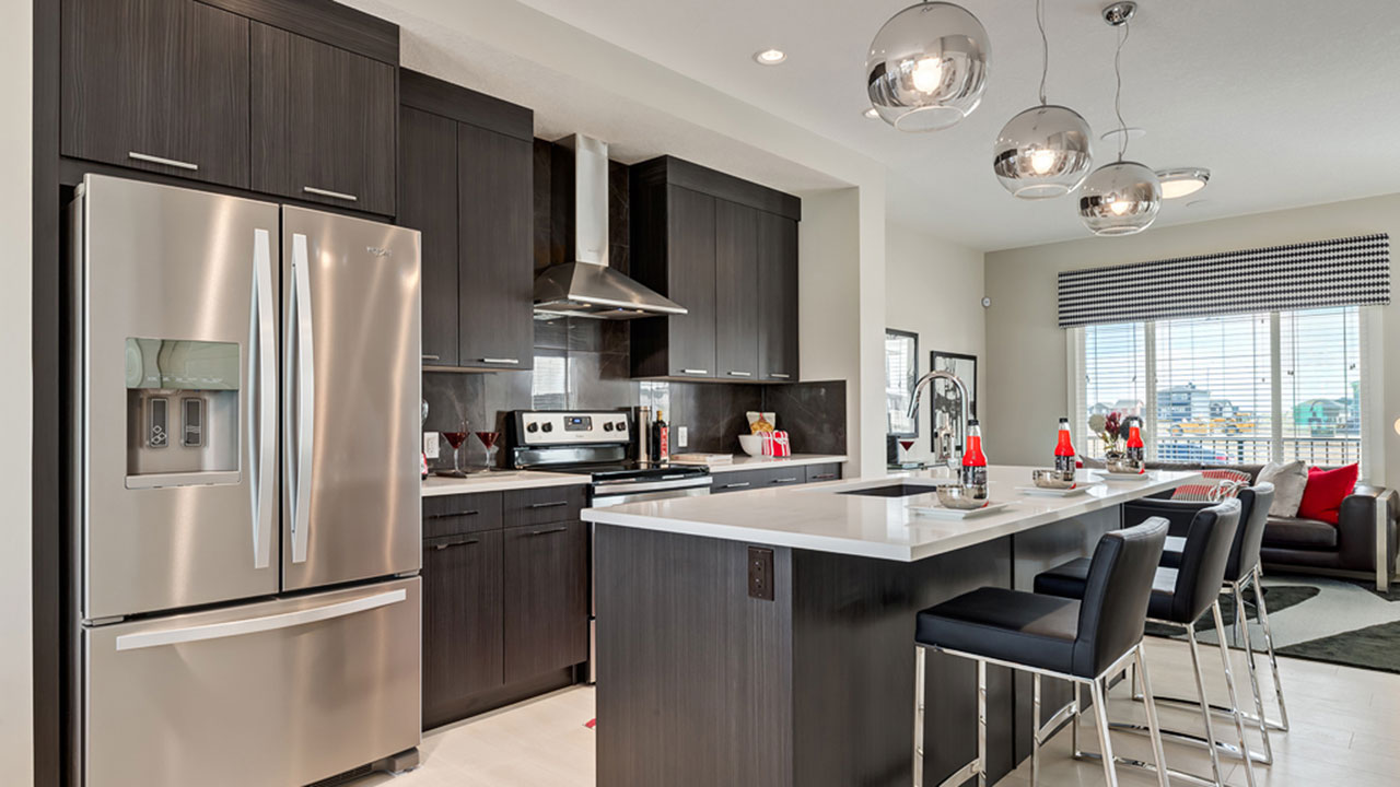 The kitchen is beautifully designed in the Middleton model, built by Pacesetter Homes in Calgary.