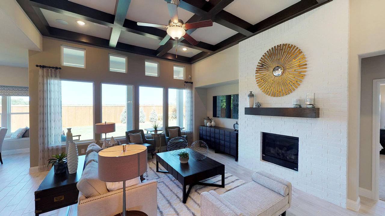 The elegant living room within Pacesetter Homes' showhome in Creek Crossing.