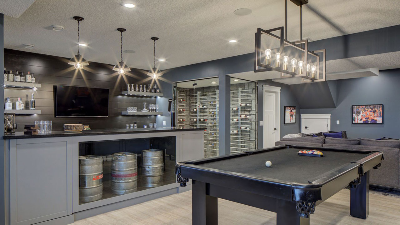 trendy bar, wine cellar and pool table in the basement of a Sterling Homes Edmonton showhome.