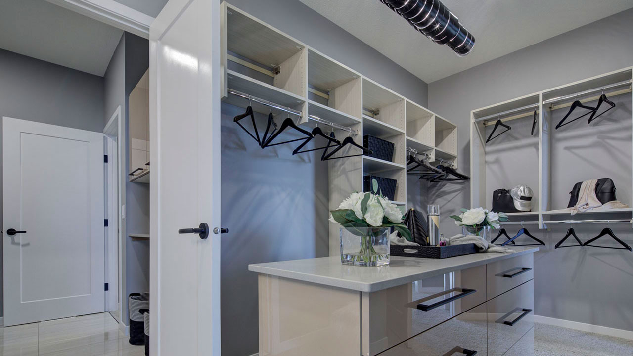 Walk in closet in a Sterling Homes Edmonton showhome