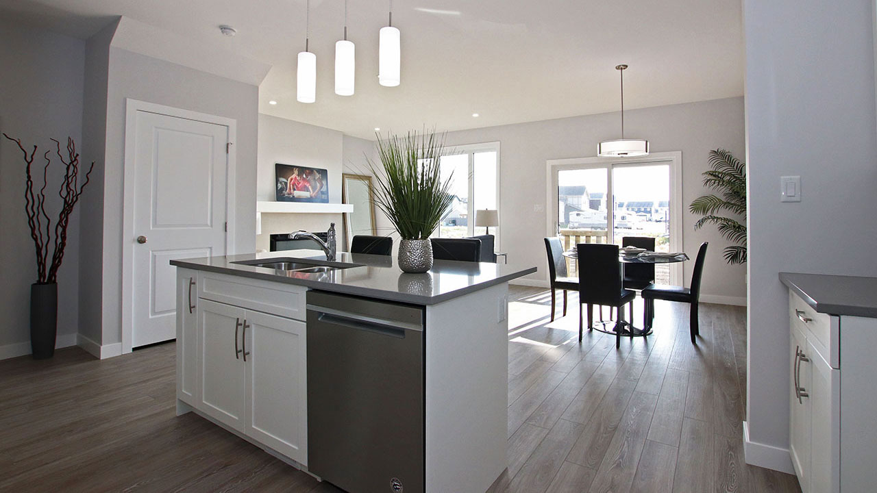 Kitchen island in front of dining room in a Pacesetter home in Regina.
