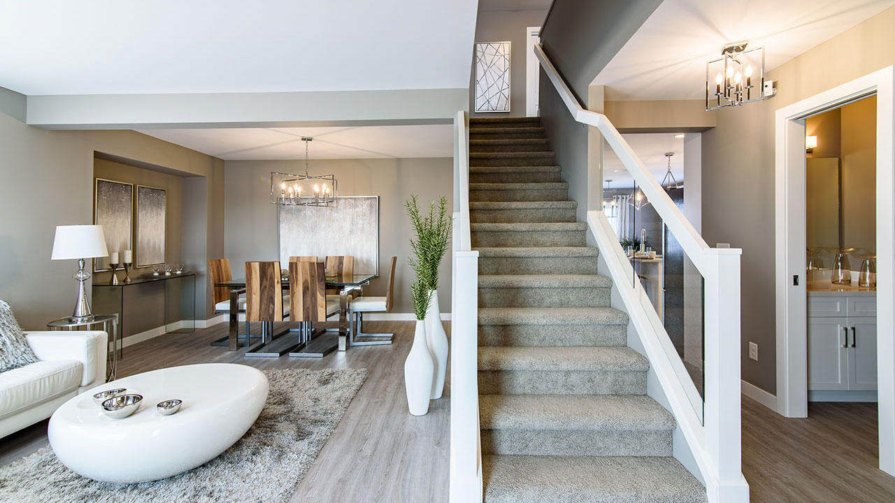 Stairwell separates dinning and living room from bathroom