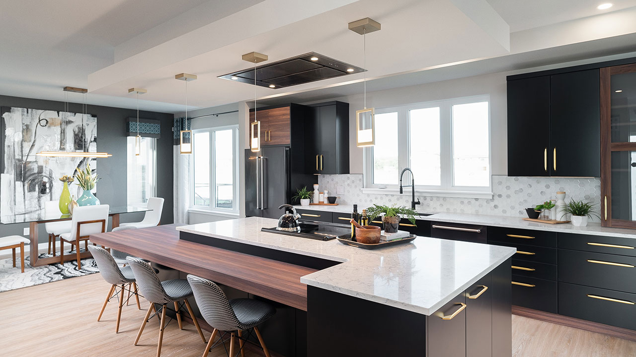 Kitchen design uses black and white and wood grains for design.