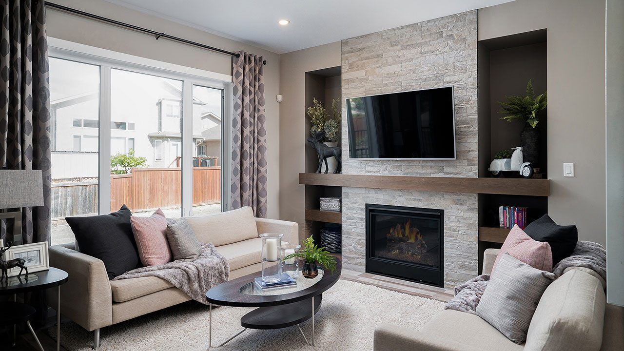 The fireplace in this Kensington Home adds to the character of the home.