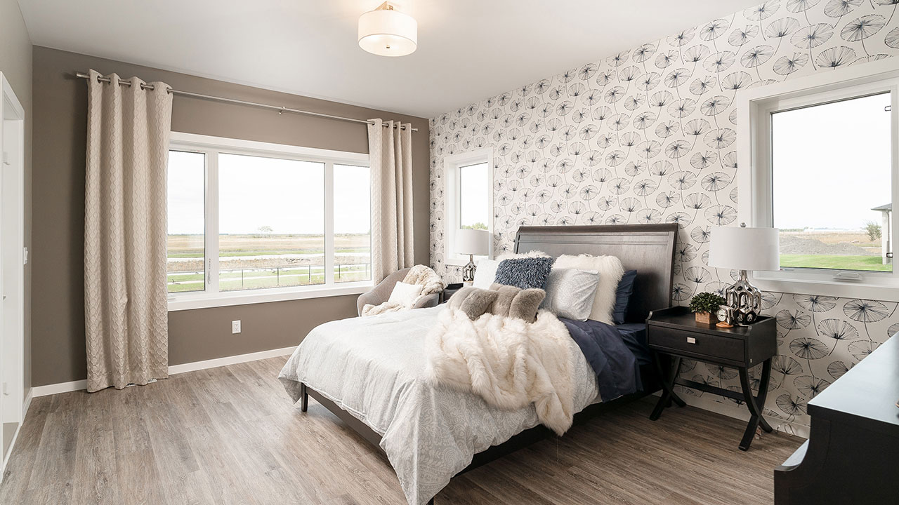 With windows on two sides on this bedroom, it provides ample natural light.