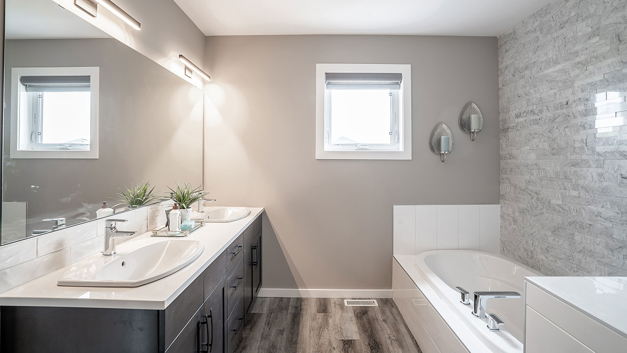 Bathroom with two sinks in a model built by Kensington Homes.