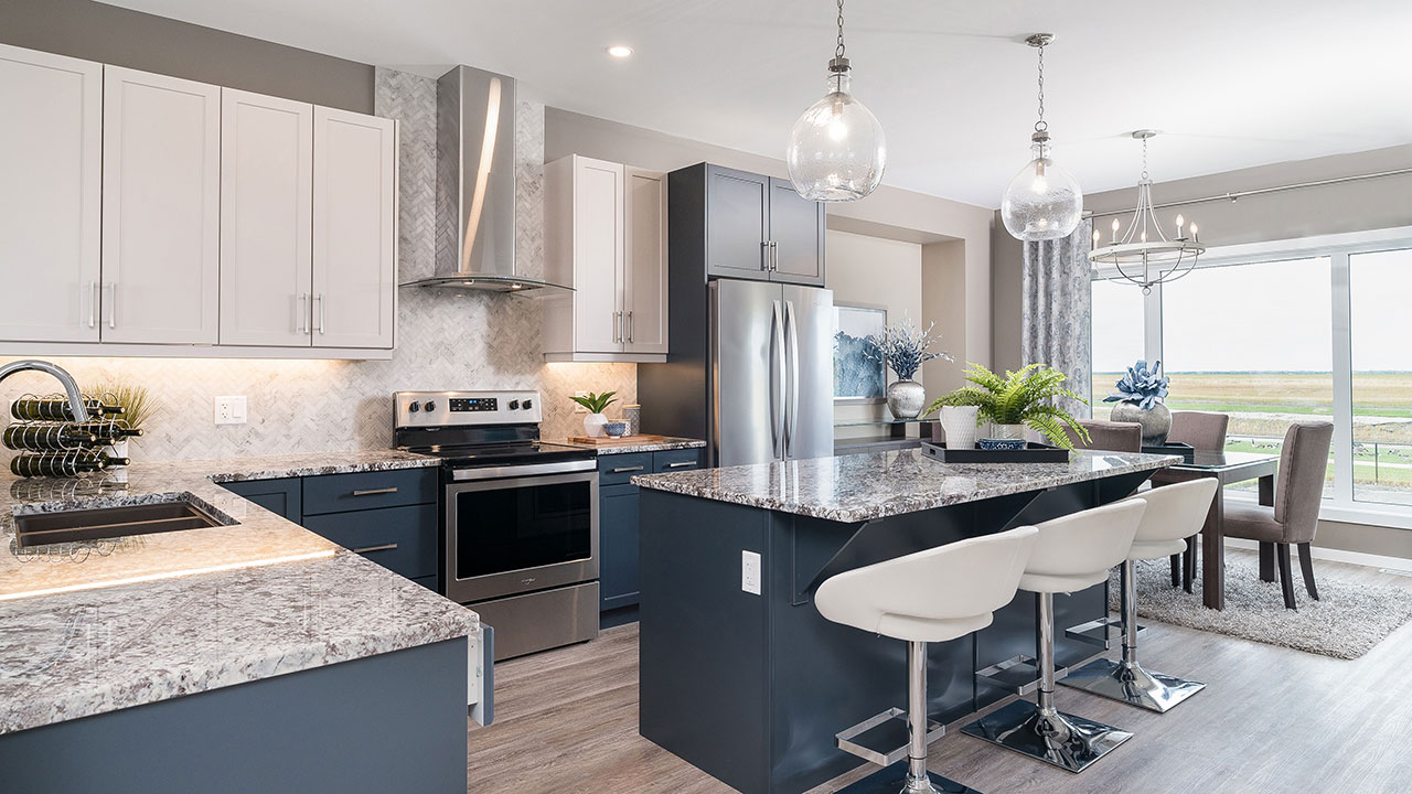 The use of navy blue, grey and white gives this kitchen style.