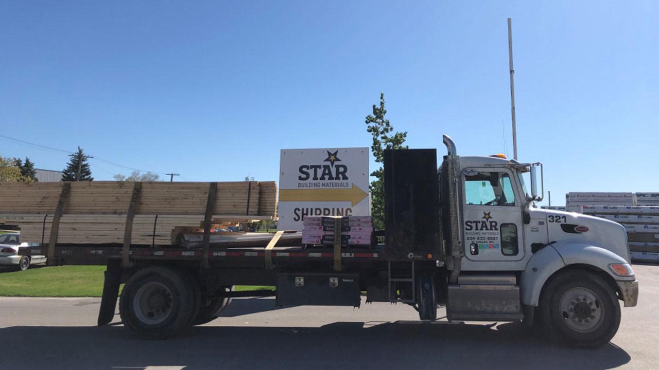 Truck entering shipping yard at Star Building Materials in Winnipeg.