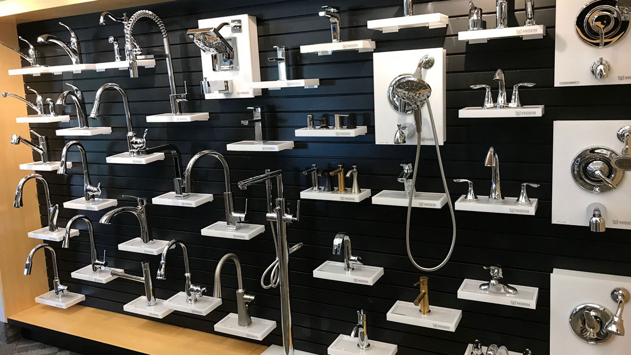 Bathroom fixtures displayed on a showroom wall.