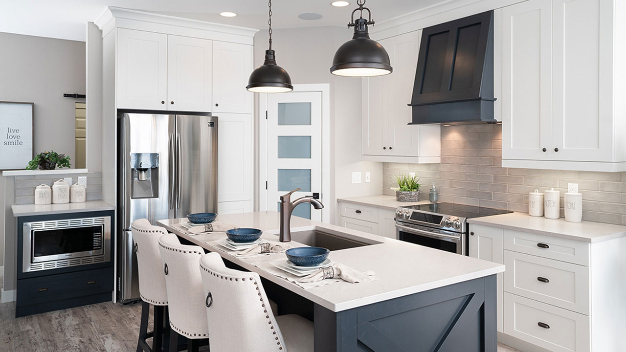 A white and black kitchen designed in a Sterling Home in Winnipeg.