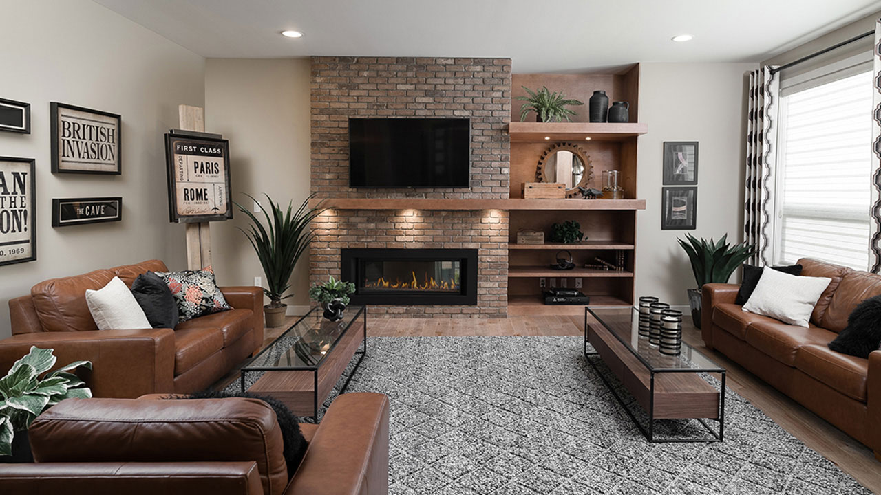 A living room featuring a brick fireplace in a Sterling Home in Winnipeg.