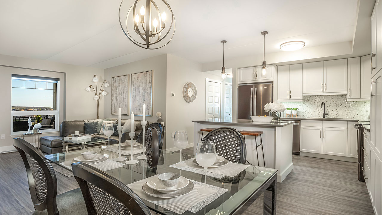 A dining room and kitchen in The Rise by Streetside Developments in Winnipeg.