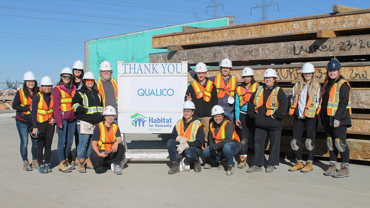 Qualico employees in Edmonton participate in a Habitat for Humanity team build