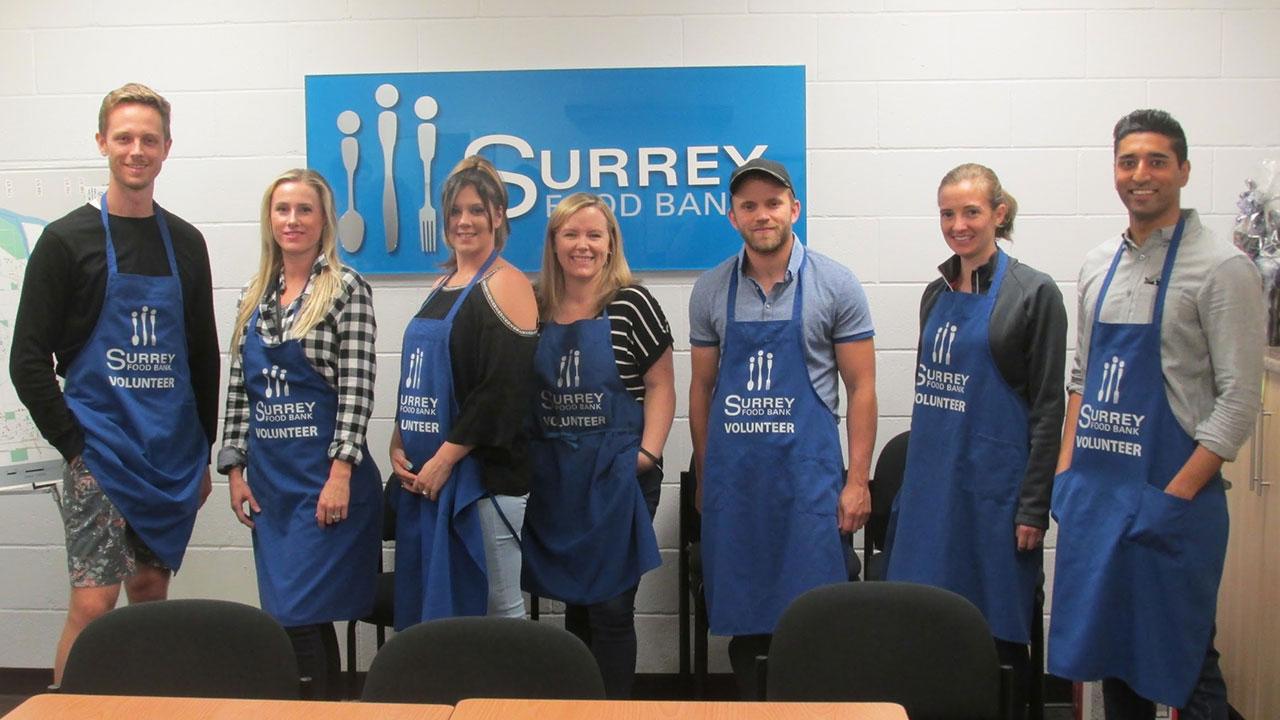 Surrey team members dedicate a day volunteering at the Surrey Food Bank