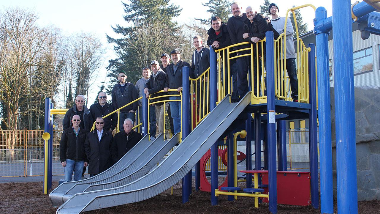 Foxridge Homes employees help install new playground at Sunnyside Elementary School