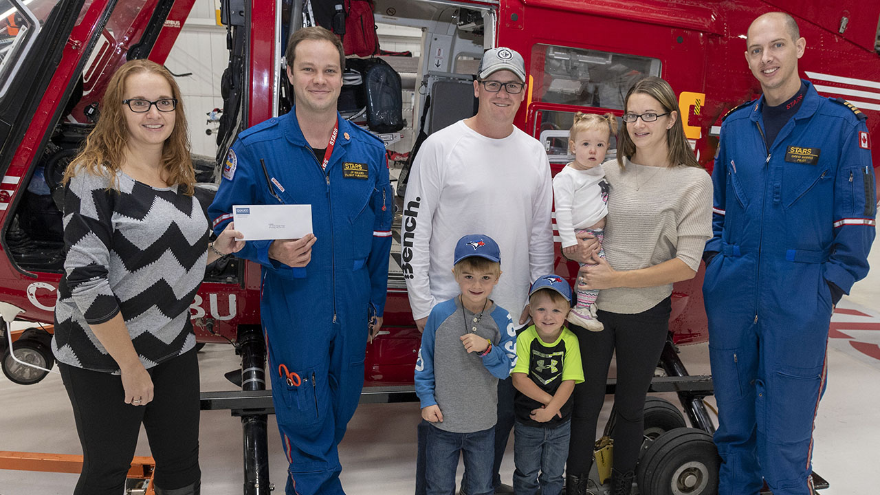 STARS Air Ambulance crew receiving Act of Kindness donation