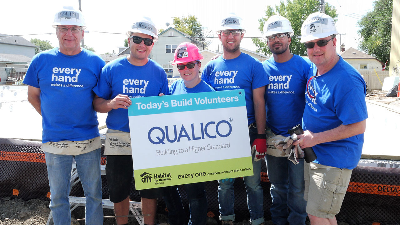 Qualico employees volunteer at the first Habitat for Humanity net-zero build
