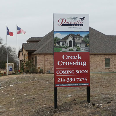 Showhome with sign at Creek Crossing in Dallas.