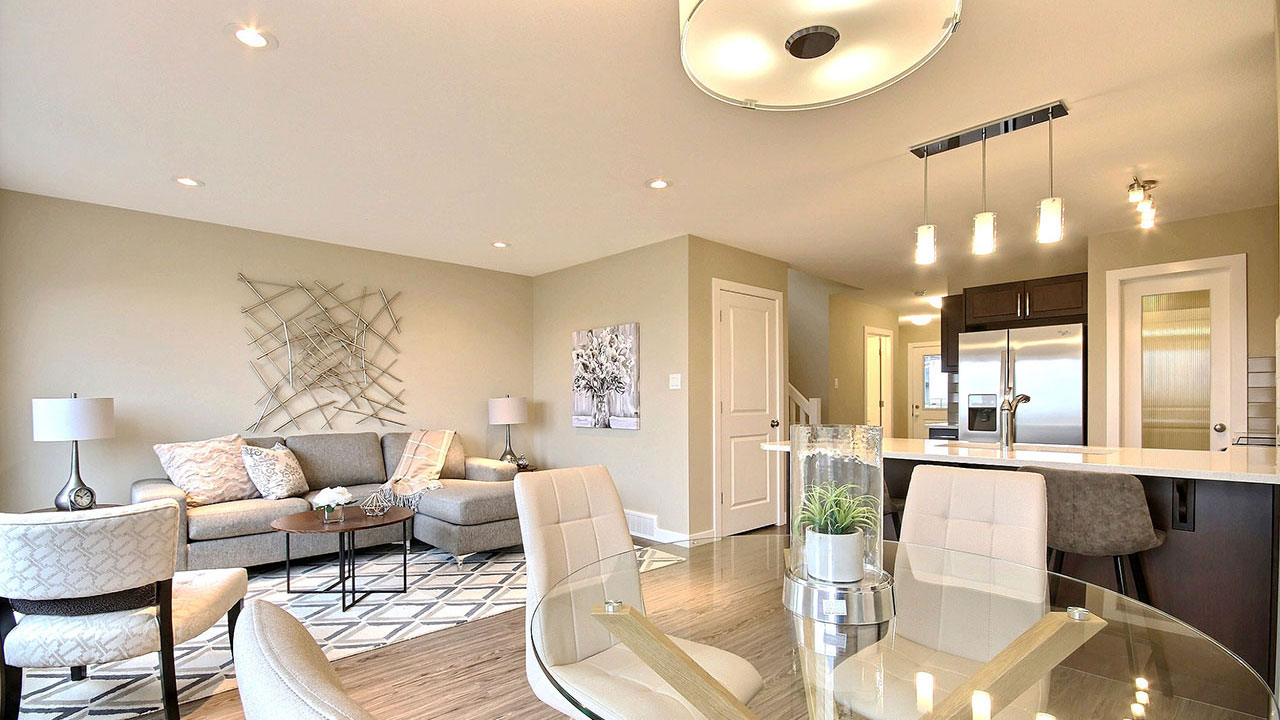 Living room and kitchen inside a Pacesetter home in Regina.