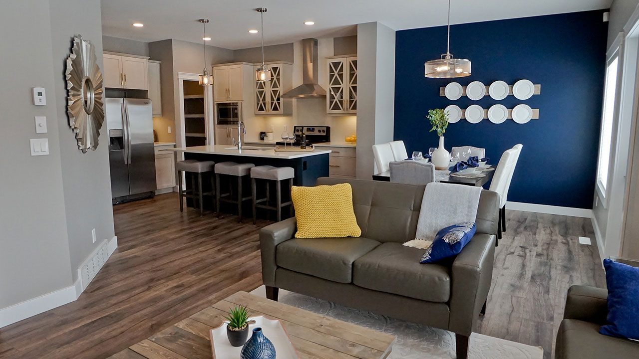 Living room and kitchen in a model built by Monatan Homes in Edmonton.