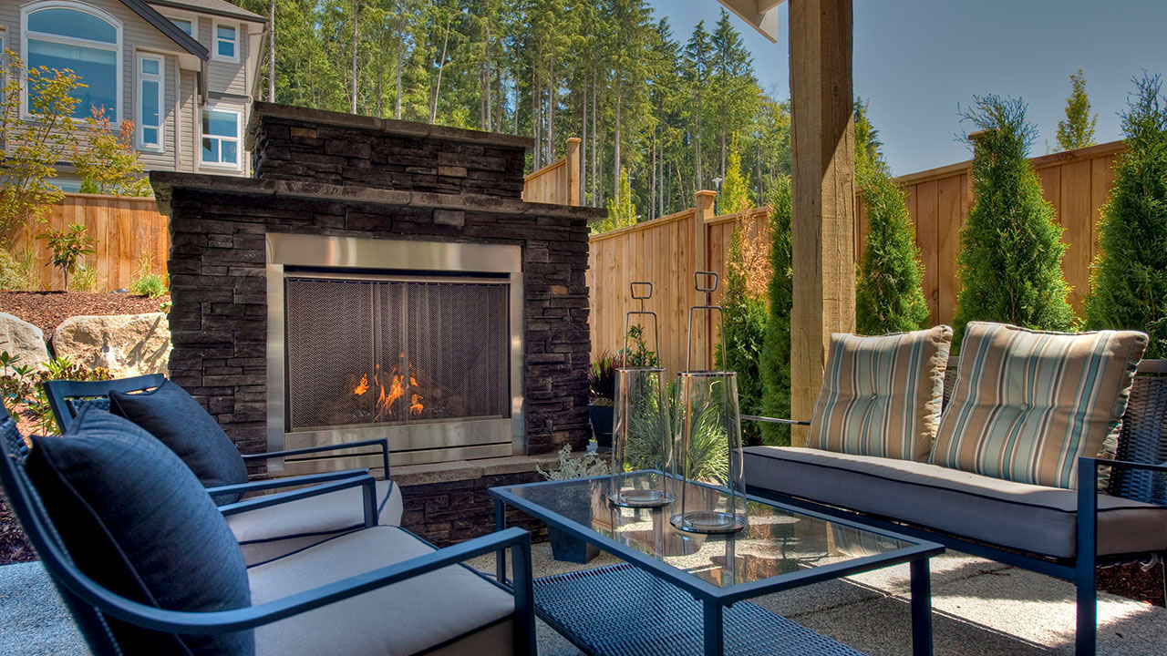 An outdoor patio of a Foxridge home inBurke Mountain