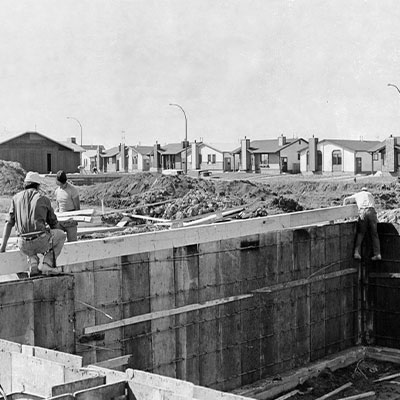 Workers on a Winnipeg job site construct forms for a basement.