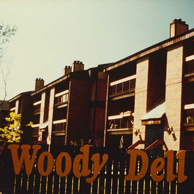 Dated image of Woody Dell, a mutli-family development in Winnipeg.