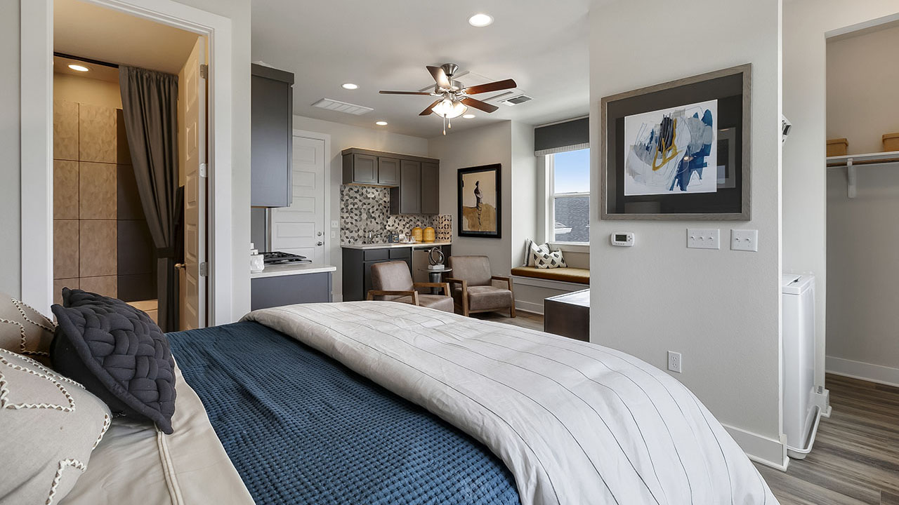 Bed area in a QUAD model built by Pacesetter Homes in Austin.