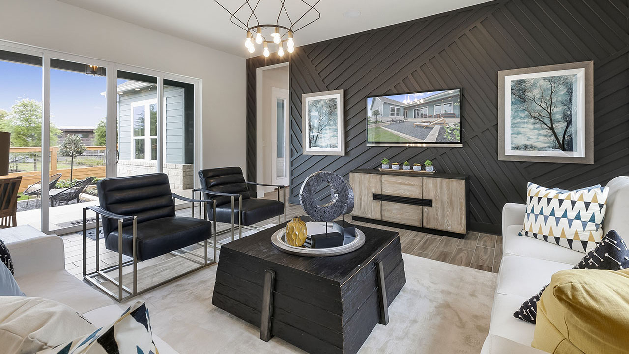 The living room within the QUAD model by Pacesetter Homes in Austin.